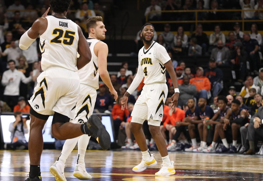Iowa Hawkeyes guard Isaiah Moss (4) celebrates after making a three point basket against the Illinois Fighting Illini Sunday, January 20, 2019 at Carver-Hawkeye Arena. (Brian Ray/hawkeyesports.com)