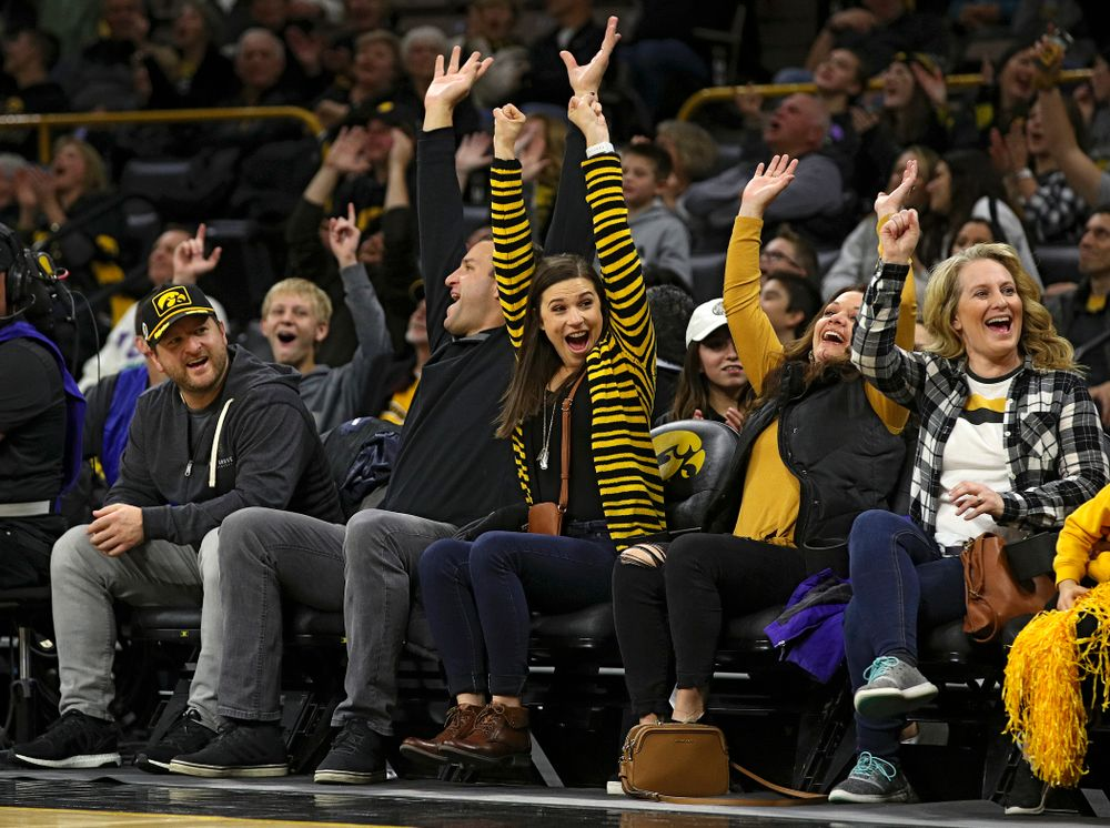 Iowa fans cheer after a fan made a putt across the court during a timeout in the first half of their game at Carver-Hawkeye Arena in Iowa City on Friday, Nov 8, 2019. (Stephen Mally/hawkeyesports.com)