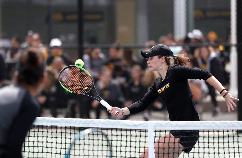 Elise Van Heuvelen and Anastasia Reimchen play a doubles match against the Wisconsin Badgers Sunday, April 22, 2018 at the Hawkeye Tennis and Recreation Center. (Brian Ray/hawkeyesports.com)