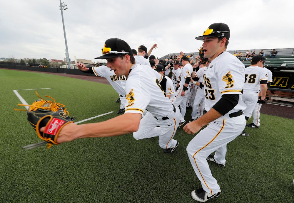 Iowa Hawkeyes outfielder Ben Norman (9) and infielder Kyle Crowl (23) take the field against the Missouri Tigers Tuesday, May 1, 2018 at Duane Banks Field. (Brian Ray/hawkeyesports.com)