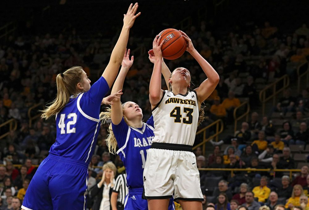 Iowa Hawkeyes forward Amanda Ollinger (43) puts up a shot during the fourth quarter of their game at Carver-Hawkeye Arena in Iowa City on Saturday, December 21, 2019. (Stephen Mally/hawkeyesports.com)