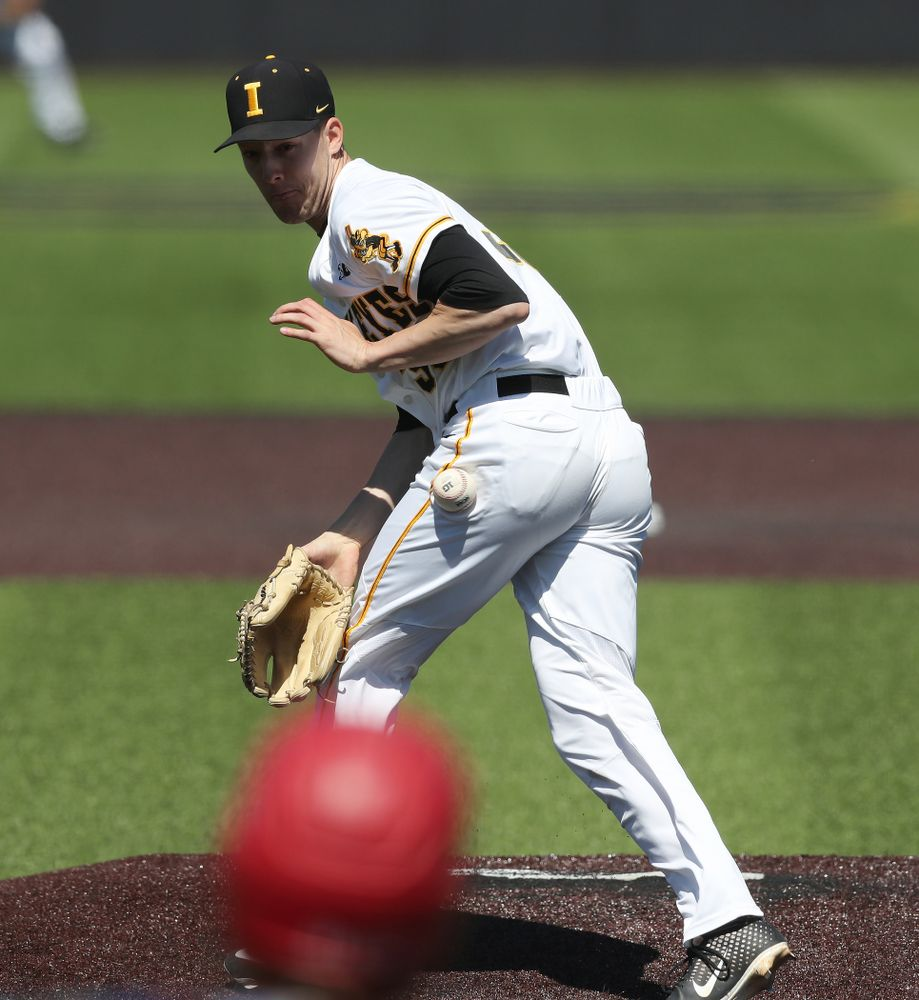 Iowa Hawkeyes Cam Baumann (35) gets hit by a ball on the mound  against the Nebraska Cornhuskers Saturday, April 20, 2019 at Duane Banks Field. (Brian Ray/hawkeyesports.com)
