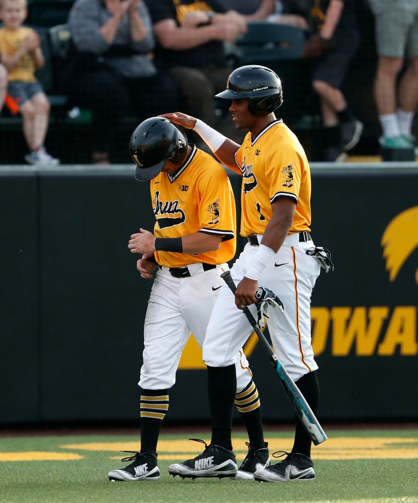 Iowa Hawkeyes third baseman Lorenzo Elion (1) and infielder Mitchell Boe (4) against the Penn State Nittany Lions Saturday, May 19, 2018 at Duane Banks Field. (Brian Ray/hawkeyesports.com)