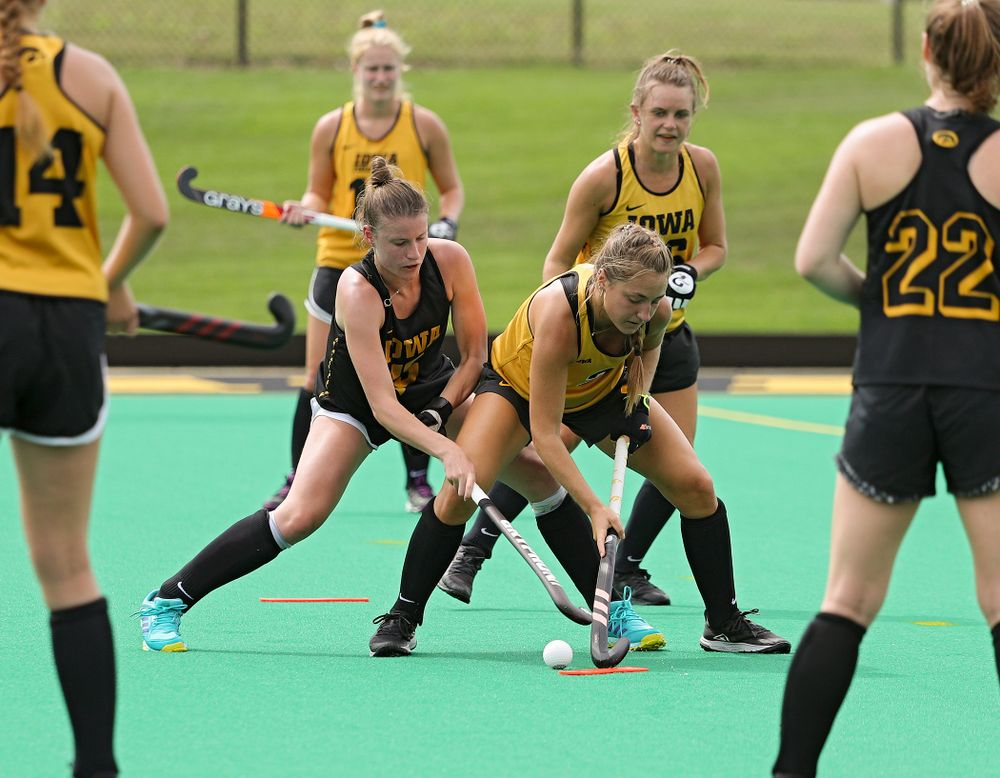 Iowa's Esme Gibson (15) and Emily Deuell (2) run a drill during practice at Grant Field in Iowa City on Thursday, Aug 15, 2019. (Stephen Mally/hawkeyesports.com)