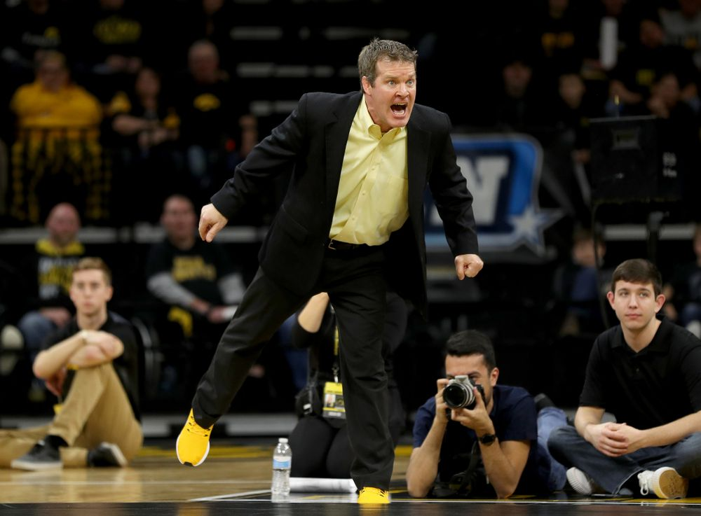 Iowa head coach Tom Brands works the sideline as Michael Kemerer wrestles Ohio State's Kaleb Romero at 174 pounds Friday, January 24, 2020 at Carver-Hawkeye Arena. Kemerer won the match 7-1. (Brian Ray/hawkeyesports.com)