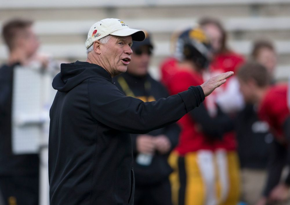 Iowa Hawkeyes defensive line coach Reese Morgan works with his unit during spring practice Wednesday, April 16, 2014 at the Kinnick Stadium in Iowa City.  (Brian Ray/hawkeyesports.com)