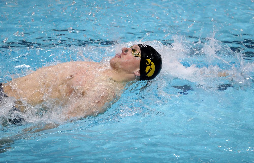 IowaÕs John Colin swims the backstroke leg of the 200 Medley Relay against Notre Dame and Illinois Saturday, January 11, 2020 at the Campus Recreation and Wellness Center.  (Brian Ray/hawkeyesports.com)