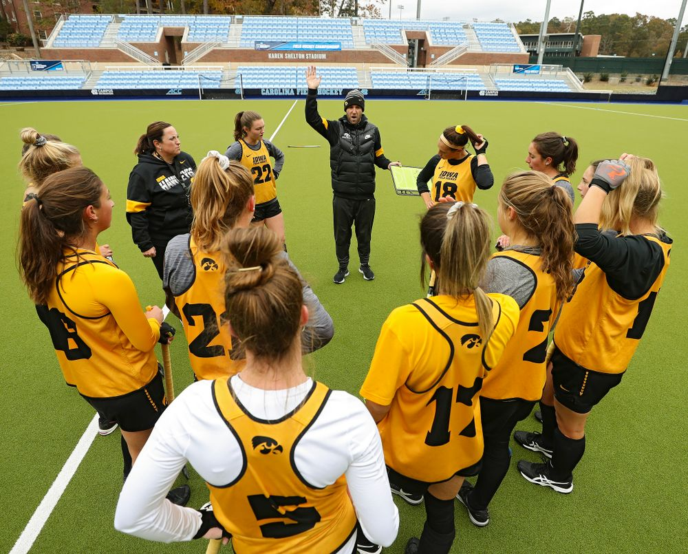 Iowa assistant coach Michael Boal talks with his team as head coach Lisa Cellucci looks on during their practice at Karen Shelton Stadium in Chapel Hill, N.C. on Thursday, Nov 14, 2019. (Stephen Mally/hawkeyesports.com)
