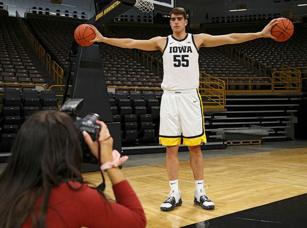 Iowa Hawkeyes forward Luka Garza (55) poses for a photo during Iowa Men's Basketball Media Day at Carver-Hawkeye Arena in Iowa City on Wednesday, Oct 9, 2019. (Stephen Mally/hawkeyesports.com)