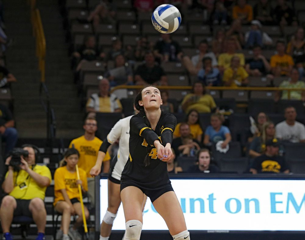 Iowa's Halle Johnston (4) eyes the ball during the third set of their Big Ten/Pac-12 Challenge match against Colorado at Carver-Hawkeye Arena in Iowa City on Friday, Sep 6, 2019. (Stephen Mally/hawkeyesports.com)