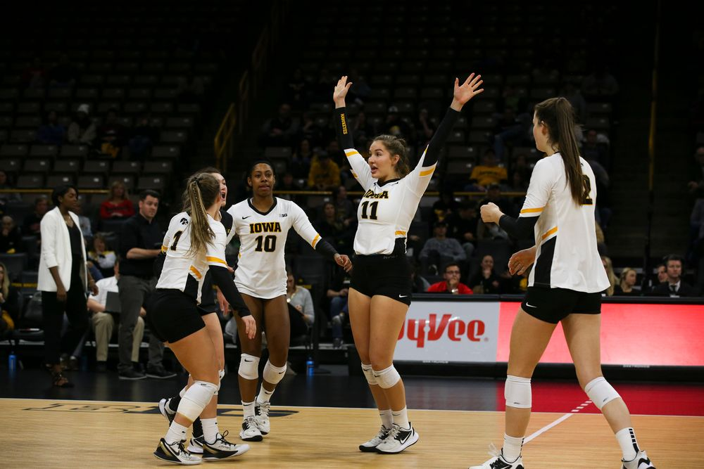 Iowa Hawkeyes outside hitter Griere Hughes (10) and Iowa Hawkeyes middle blocker Blythe Rients (11) during Iowa volleyball vs Maryland on Saturday, November 30, 2019 at Carver-Hawkeye Arena. (Lily Smith/hawkeyesports.com)
