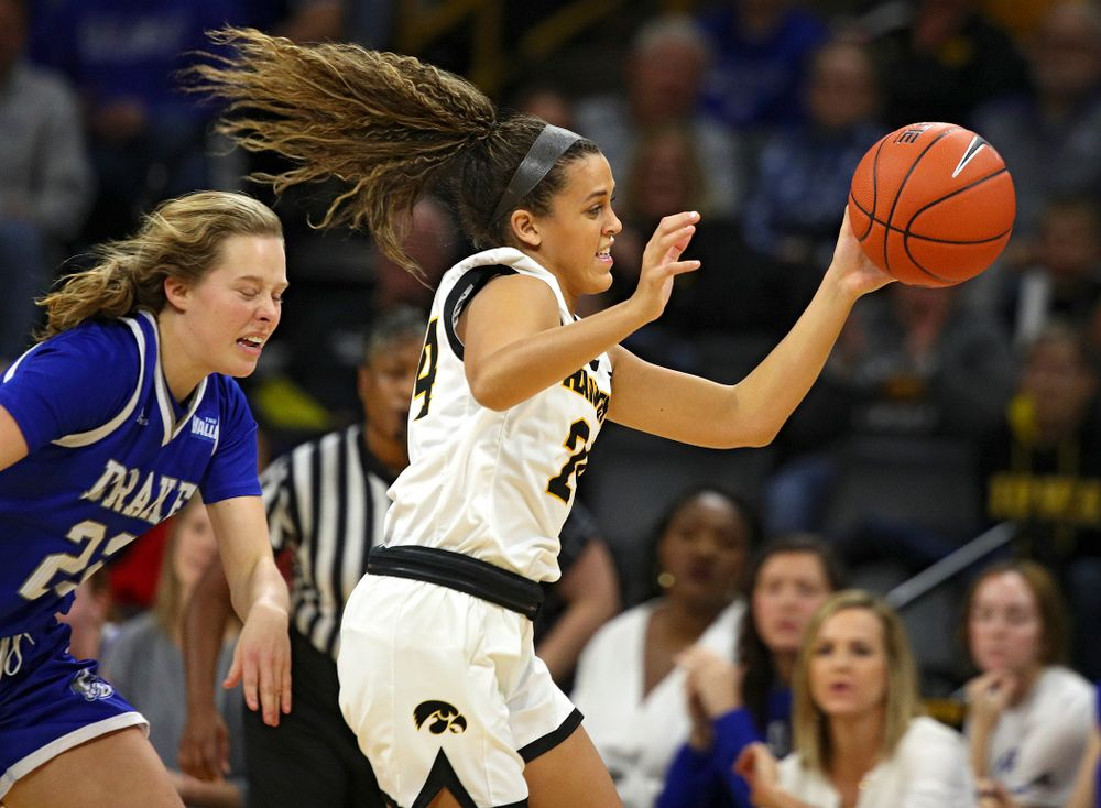 Iowa Hawkeyes guard Gabbie Marshall (24) steals the ball away during the third quarter of their game at Carver-Hawkeye Arena in Iowa City on Saturday, December 21, 2019. (Stephen Mally/hawkeyesports.com)