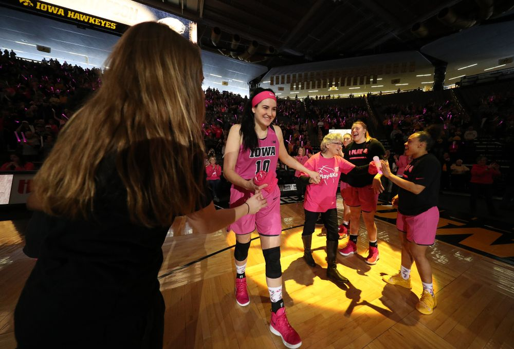 Iowa Hawkeyes forward Megan Gustafson (10)  is introduced with a cancer survivor before their game against the seventh ranked Maryland Terrapins Sunday, February 17, 2019 at Carver-Hawkeye Arena. (Brian Ray/hawkeyesports.com)