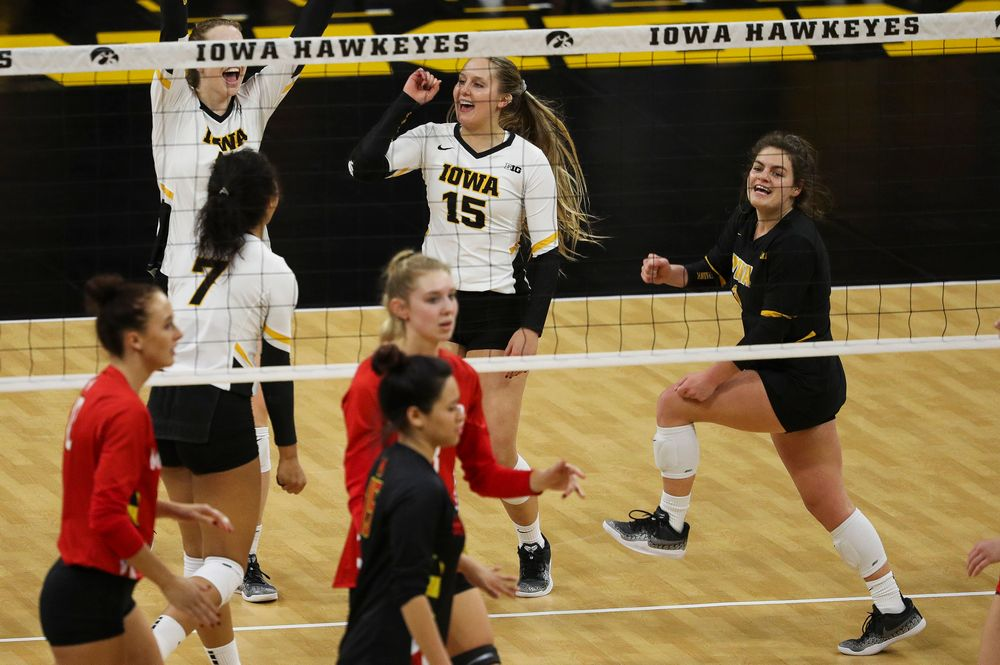 Iowa Hawkeyes defensive specialist Maddie Slagle (15) and Iowa Hawkeyes defensive specialist Molly Kelly (1) celebrate after winning a point during a match against Maryland at Carver-Hawkeye Arena on November 23, 2018. (Tork Mason/hawkeyesports.com)
