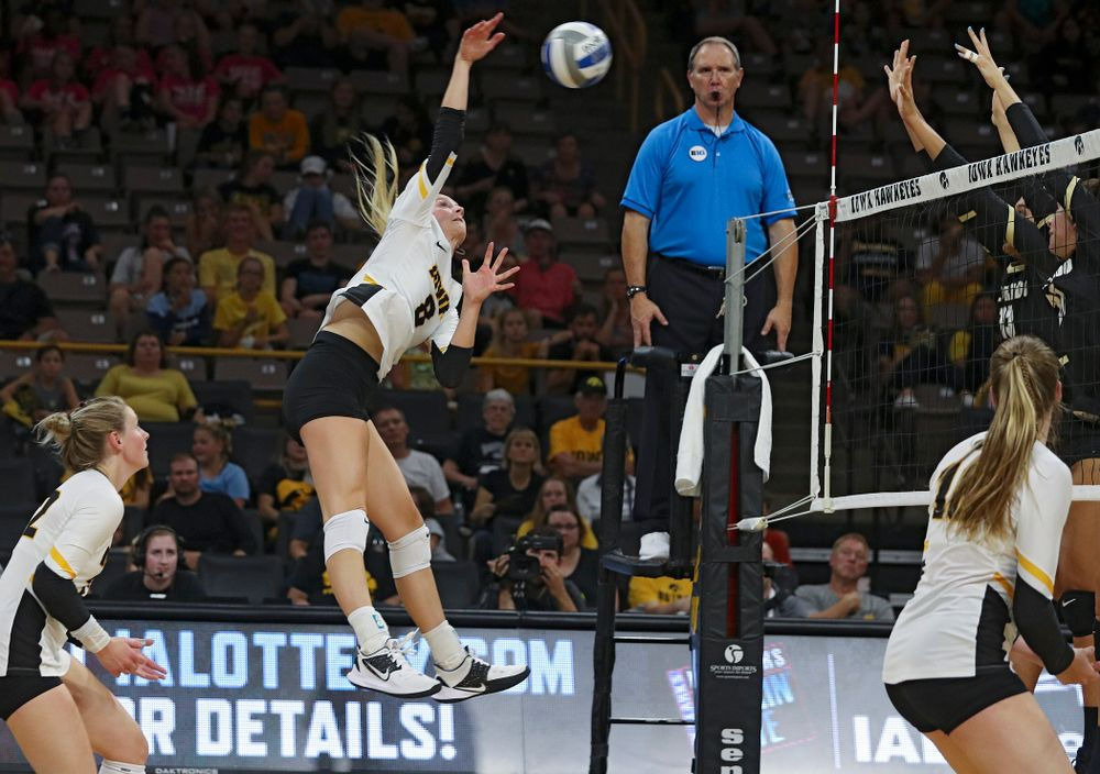 Iowa's Kyndra Hansen (8) gets up for a kill during the third set of their Big Ten/Pac-12 Challenge match against Colorado at Carver-Hawkeye Arena in Iowa City on Friday, Sep 6, 2019. (Stephen Mally/hawkeyesports.com)