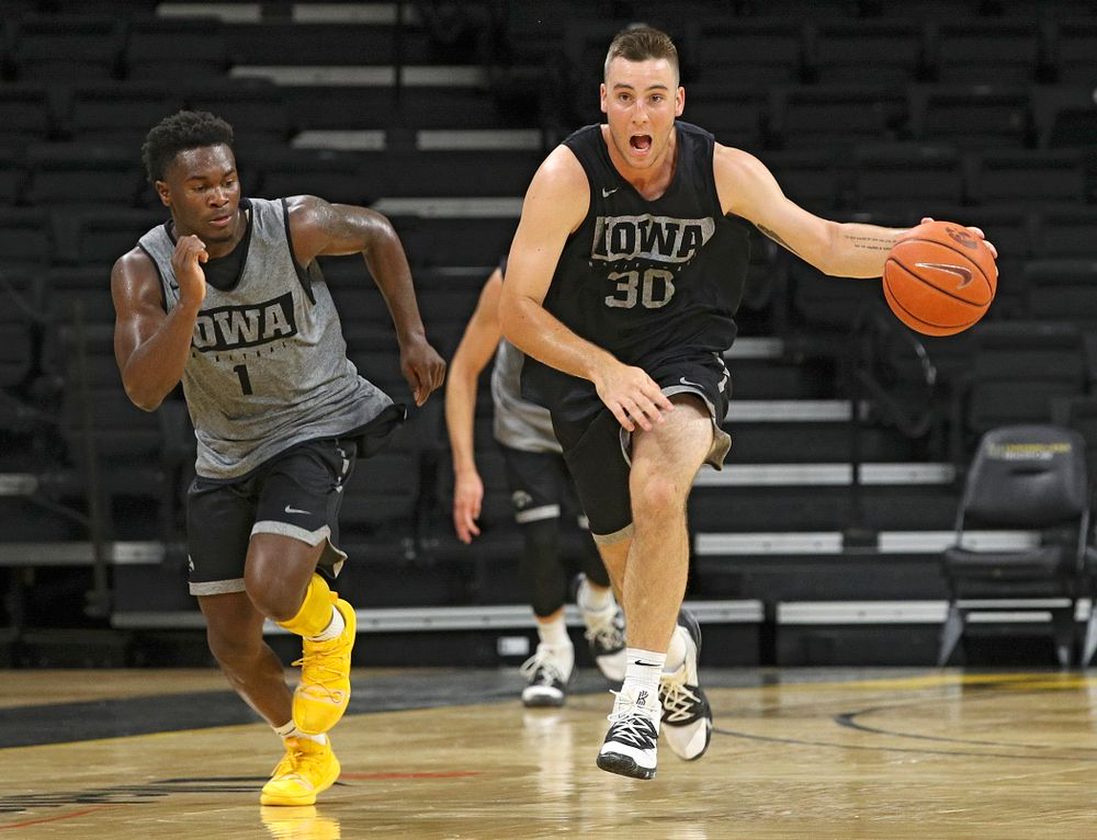 Iowa Hawkeyes guard Connor McCaffery (30) pushes the ball down the court as guard Joe Toussaint (1) gives chase during practice at Carver-Hawkeye Arena in Iowa City on Monday, Sep 30, 2019. (Stephen Mally/hawkeyesports.com)