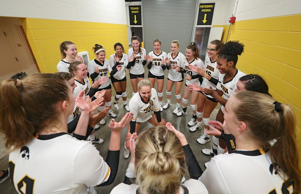 Iowa's Maddie Slagle (15) dances in their huddle before their Big Ten/Pac-12 Challenge match against Colorado at Carver-Hawkeye Arena in Iowa City on Friday, Sep 6, 2019. (Stephen Mally/hawkeyesports.com)