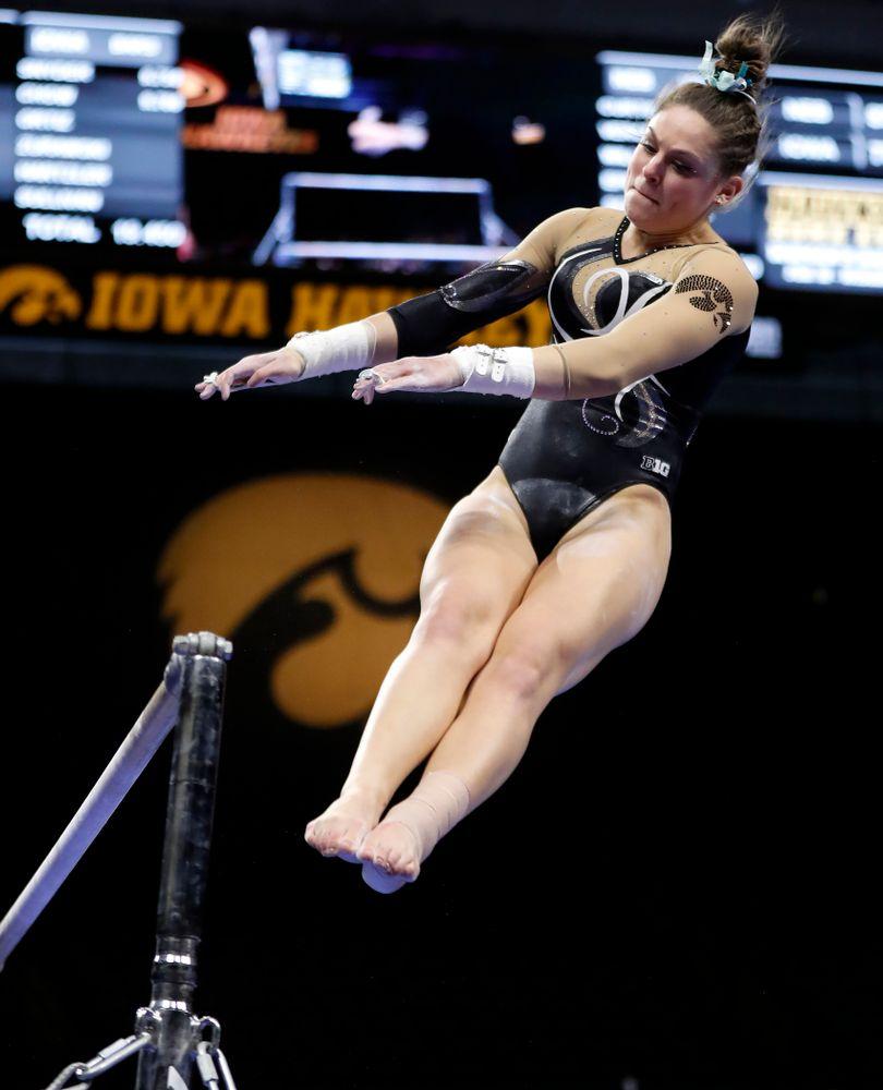 Iowa's Melissa Zurawski competes on the bars against the Nebraska Cornhuskers