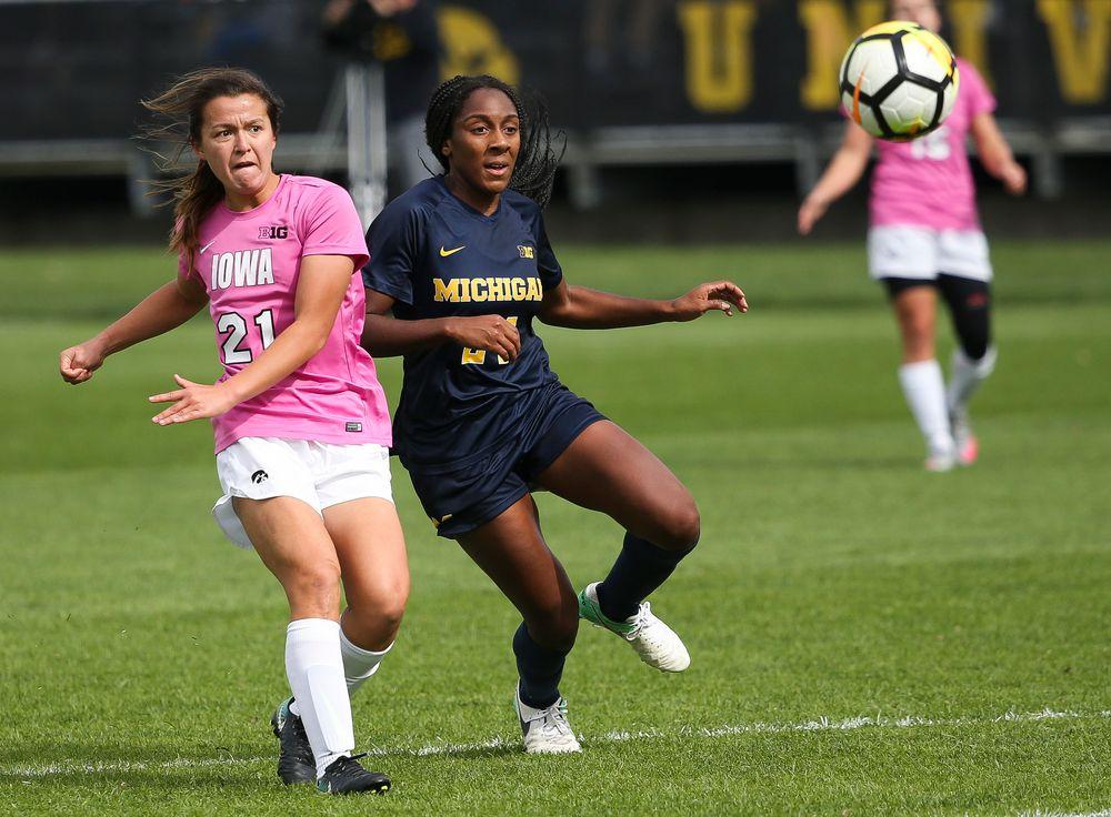 Iowa Hawkeyes forward Emma Tokuyama (21) passes the ball during a game against Michigan at the Iowa Soccer Complex on October 14, 2018. (Tork Mason/hawkeyesports.com)