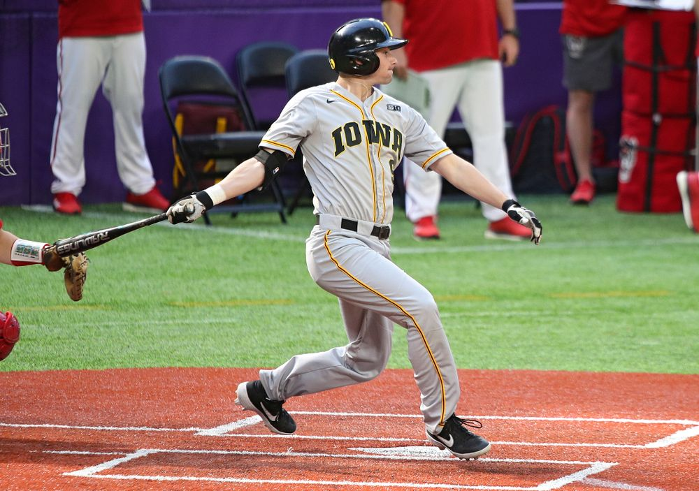 Iowa Hawkeyes outfielder Ben Norman (9) gets a hit during the seventh inning of their CambriaCollegeClassic game at U.S. Bank Stadium in Minneapolis, Minn. on Friday, February 28, 2020. (Stephen Mally/hawkeyesports.com)