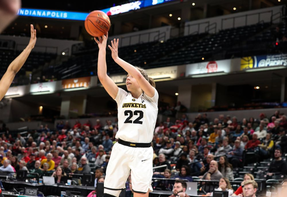 Iowa Hawkeyes guard Kathleen Doyle (22) knocks down a three point basket against the Rutgers Scarlet Knights in the semi-finals of the Big Ten Tournament Saturday, March 9, 2019 at Bankers Life Fieldhouse in Indianapolis, Ind. (Brian Ray/hawkeyesports.com)