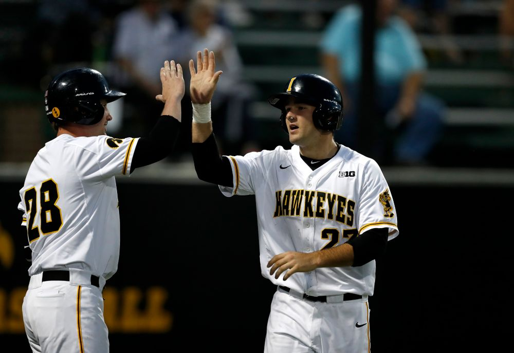 Iowa Hawkeyes infielder Kyle Crowl (23) and infielder Chris Whelan (28) against the Penn State Nittany Lions  Thursday, May 17, 2018 at Duane Banks Field. (Brian Ray/hawkeyesports.com)