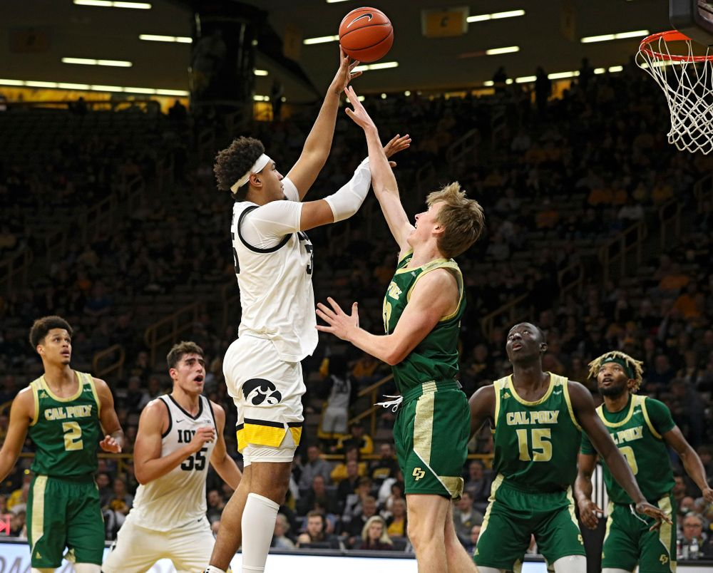 Iowa Hawkeyes forward Cordell Pemsl (35) scores a basket while being fouled during the second half of their game at Carver-Hawkeye Arena in Iowa City on Sunday, Nov 24, 2019. (Stephen Mally/hawkeyesports.com)