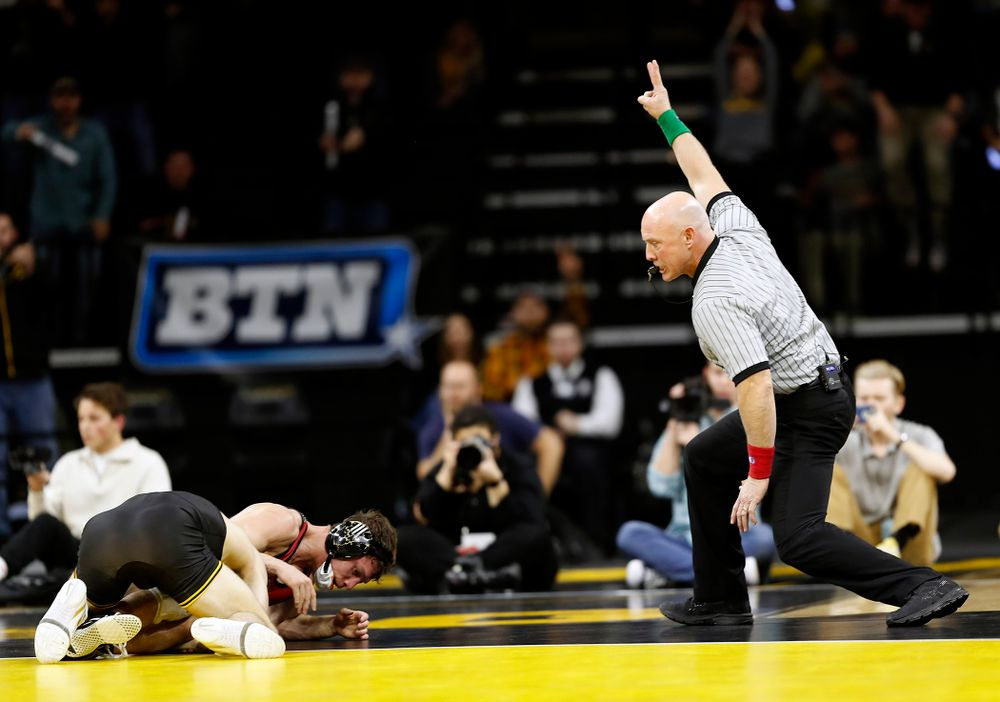 Austin DeSanto, referee Curt Frost (Darren Miller/hawkeyesports.com)