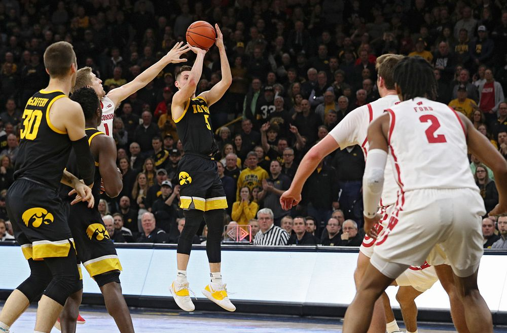 Iowa Hawkeyes guard CJ Fredrick (5) makes a 3-pointer during the second half of their game at Carver-Hawkeye Arena in Iowa City on Monday, January 27, 2020. (Stephen Mally/hawkeyesports.com)