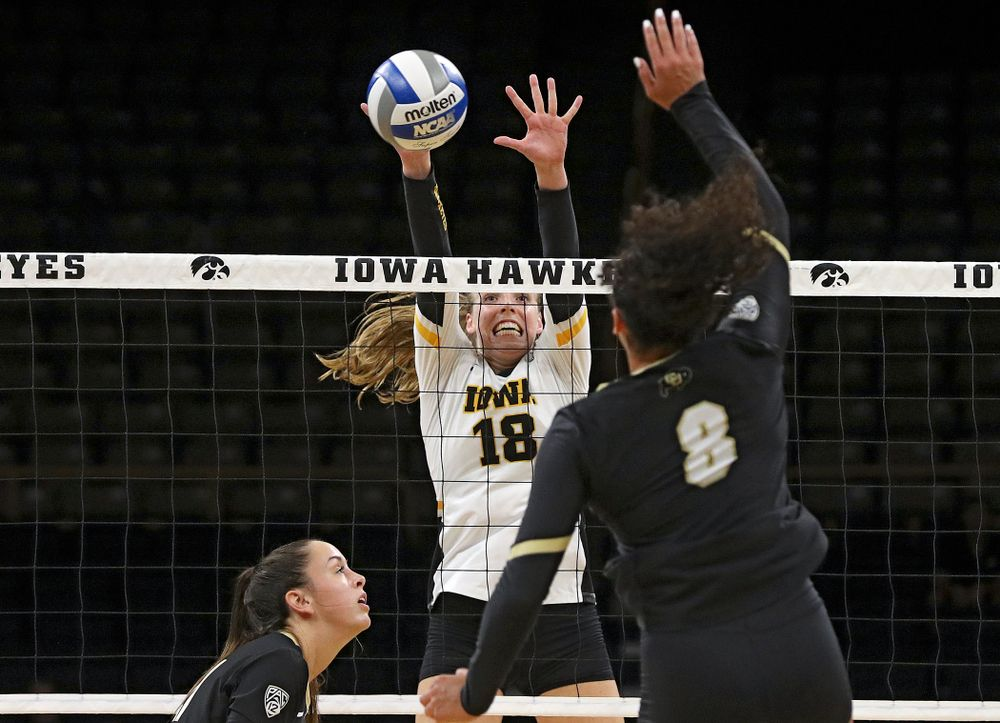Iowa's Hannah Clayton (18) gets her hands on a shot during the third set of their Big Ten/Pac-12 Challenge match against Colorado at Carver-Hawkeye Arena in Iowa City on Friday, Sep 6, 2019. (Stephen Mally/hawkeyesports.com)