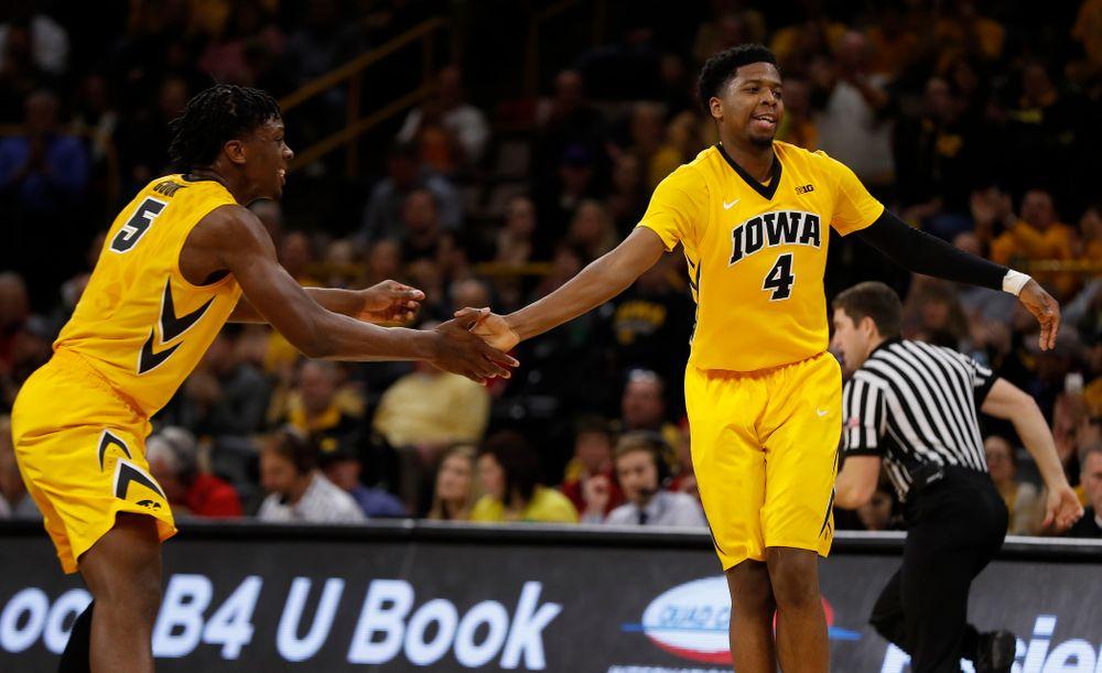Iowa Hawkeyes forward Tyler Cook (5) and guard Isaiah Moss (4)
