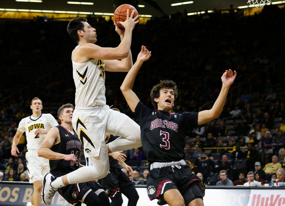 Iowa Hawkeyes forward Ryan Kriener (15) goes up for a shot during a game against Guilford College at Carver-Hawkeye Arena on November 4, 2018. (Tork Mason/hawkeyesports.com)