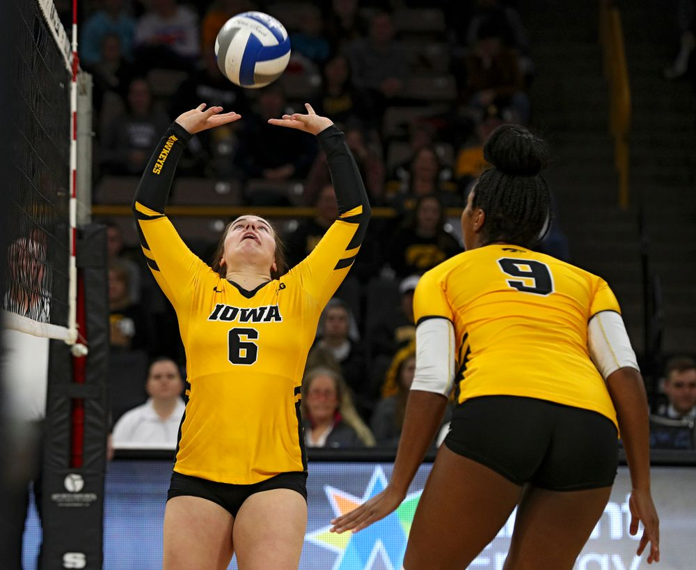 Iowa's Emma Lowes (6) sets the ball as Amiya Jones (9) looks on during the first set of their match at Carver-Hawkeye Arena in Iowa City on Friday, Nov 29, 2019. (Stephen Mally/hawkeyesports.com)
