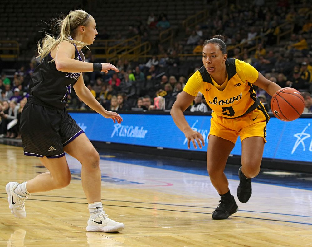 Iowa guard Alexis Sevillian (5) drives with the ball during the third quarter of their game against Winona State at Carver-Hawkeye Arena in Iowa City on Sunday, Nov 3, 2019. (Stephen Mally/hawkeyesports.com)