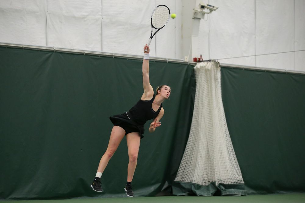Iowa's Samantha Mannix serves a ball during the Iowa women's tennis meet vs UNI  on Saturday, February 29, 2020 at the Hawkeye Tennis and Recreation Complex. (Lily Smith/hawkeyesports.com)