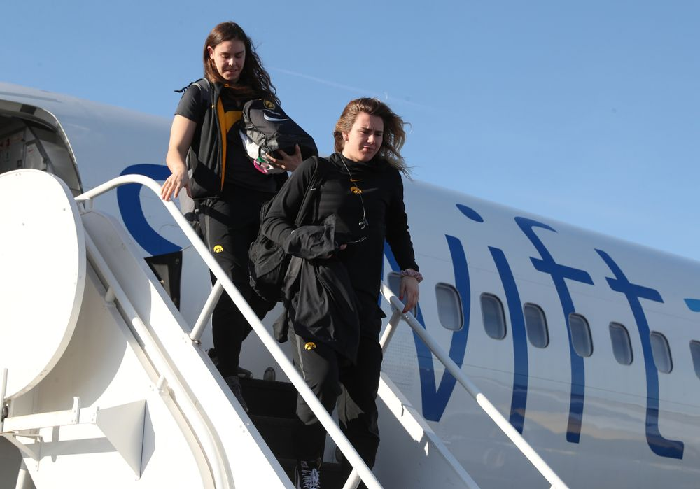 Iowa Hawkeyes forward Hannah Stewart (21) arrives in Greensboro, NC for the Regionals of the 2019 NCAA Women's Basketball Championships Thursday, March 28, 2019 at the Eastern Iowa Airport. (Brian Ray/hawkeyesports.com)