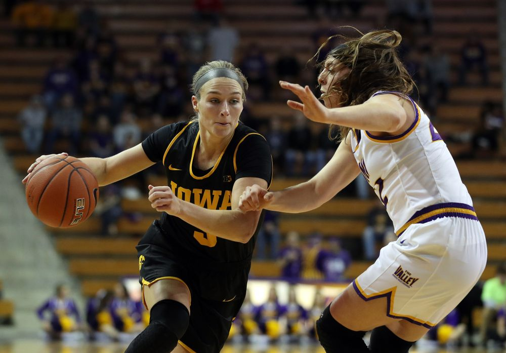 Iowa Hawkeyes guard Makenzie Meyer (3) drives to the hoop against Northern IowaÕs Rose Simon-Ressler (22) Sunday, November 17, 2019 at the McLeod Center. (Brian Ray/hawkeyesports.com)
