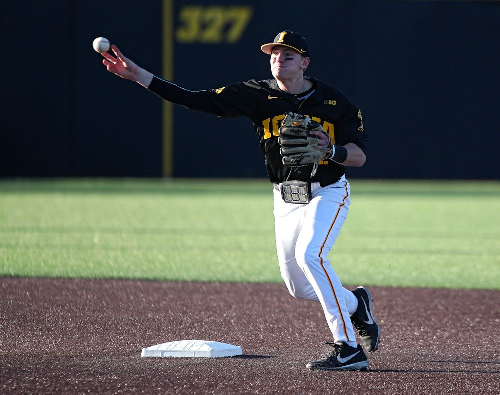 Iowa infielder Brendan Sher (2) throws to first to complete a double play during the third inning of their game at Duane Banks Field in Iowa City on Tuesday, March 3, 2020. (Stephen Mally/hawkeyesports.com)