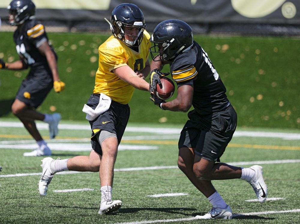 Iowa Hawkeyes quarterback Alex Padilla (8) hands the ball off to running back Tyler Goodson (15) during Fall Camp Practice No. 7 at the Hansen Football Performance Center in Iowa City on Friday, Aug 9, 2019. (Stephen Mally/hawkeyesports.com)