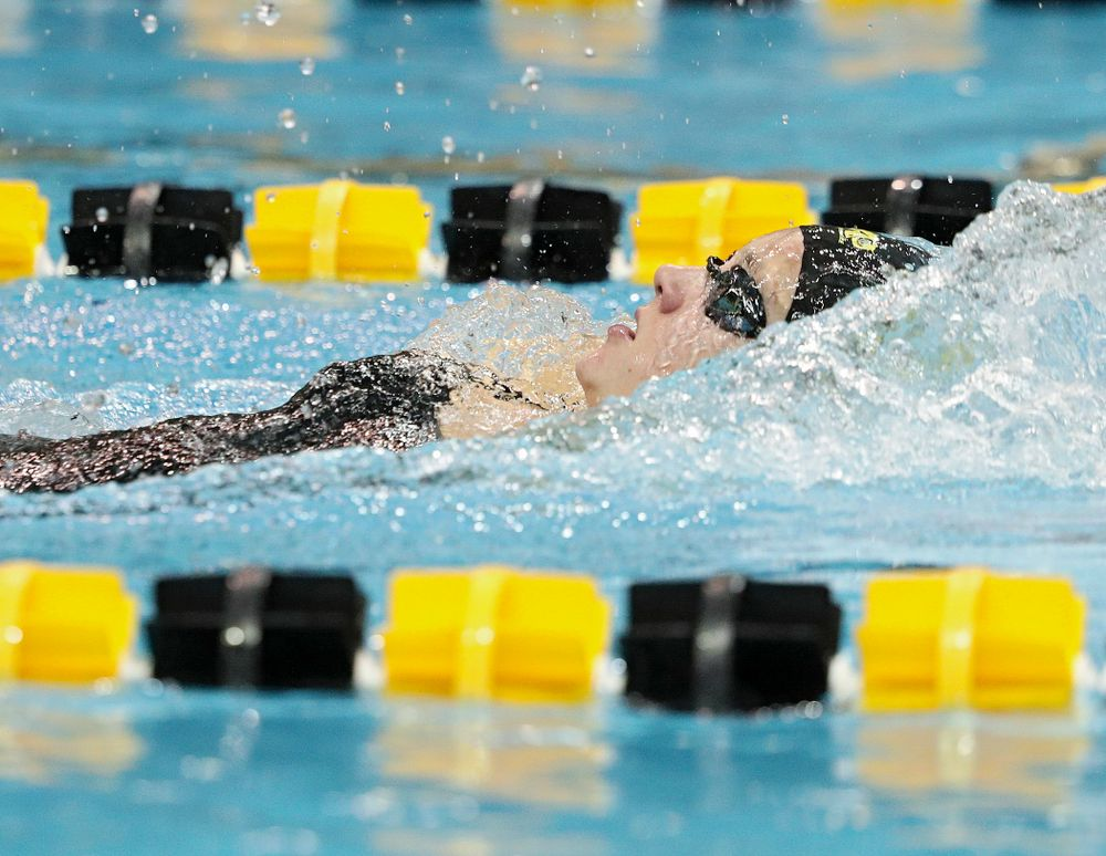 Iowa's Macy Rink swims the backstroke section of the 100-yard individual medley event during their meet against Michigan State at the Campus Recreation and Wellness Center in Iowa City on Thursday, Oct 3, 2019. (Stephen Mally/hawkeyesports.com)