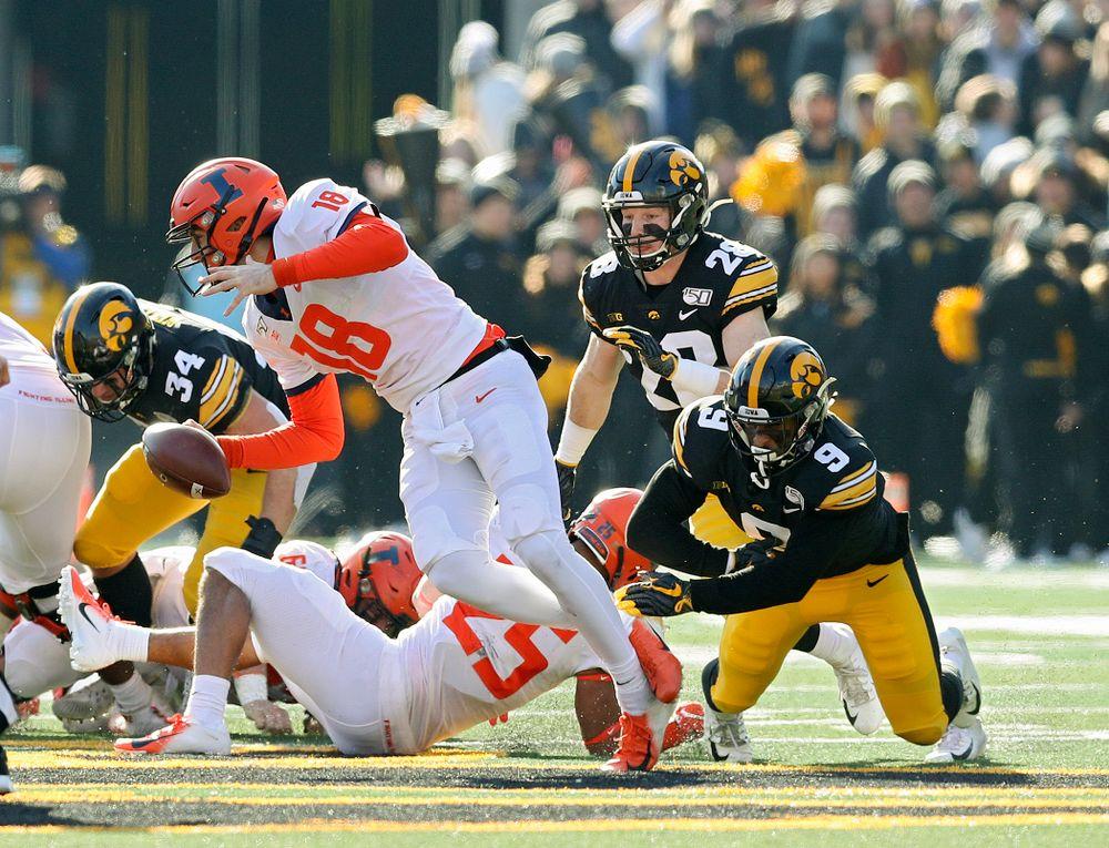 Iowa Hawkeyes defensive back Geno Stone (9) sacks Illinois Fighting Illini quarterback Brandon Peters (18) during the second quarter of their game at Kinnick Stadium in Iowa City on Saturday, Nov 23, 2019. (Stephen Mally/hawkeyesports.com)