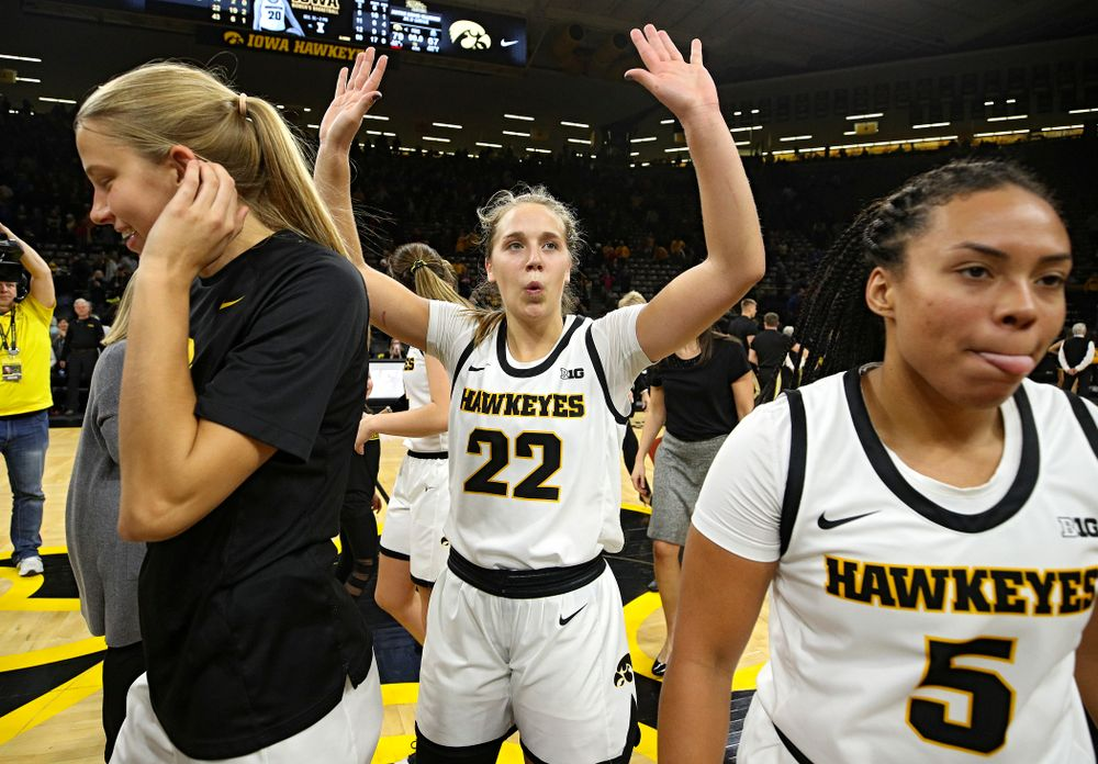 Iowa Hawkeyes guard Kathleen Doyle (22) celebrates with her teammates after their game at Carver-Hawkeye Arena in Iowa City on Saturday, December 21, 2019. (Stephen Mally/hawkeyesports.com)