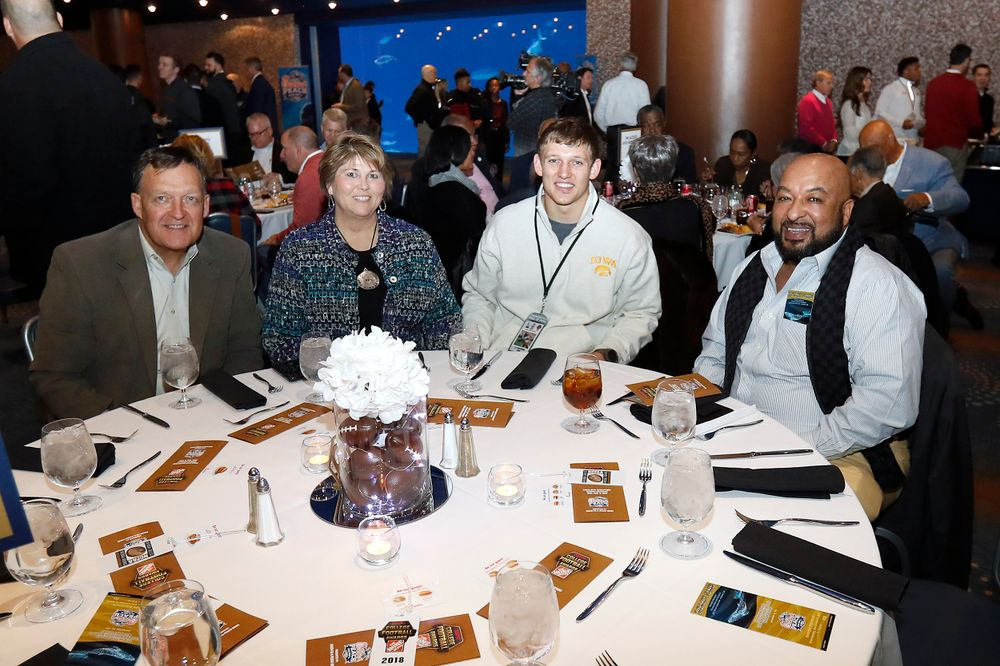 Tod, Teri, and T.J. Hockenson are joined for dinner by Jerry Mackey, son of the late John Mackey.