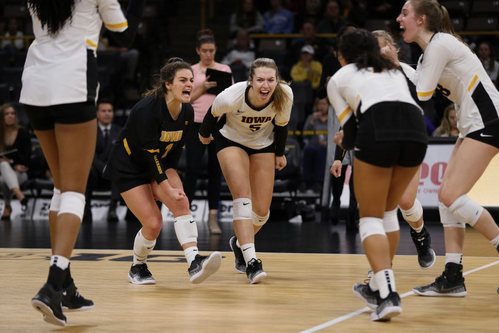 Iowa Hawkeyes defensive specialist Molly Kelly (1) and outside hitter Meghan Buzzerio (5) against the Ohio State Buckeyes Saturday, November 24, 2018 at Carver-Hawkeye Arena. (Brian Ray/hawkeyesports.com)