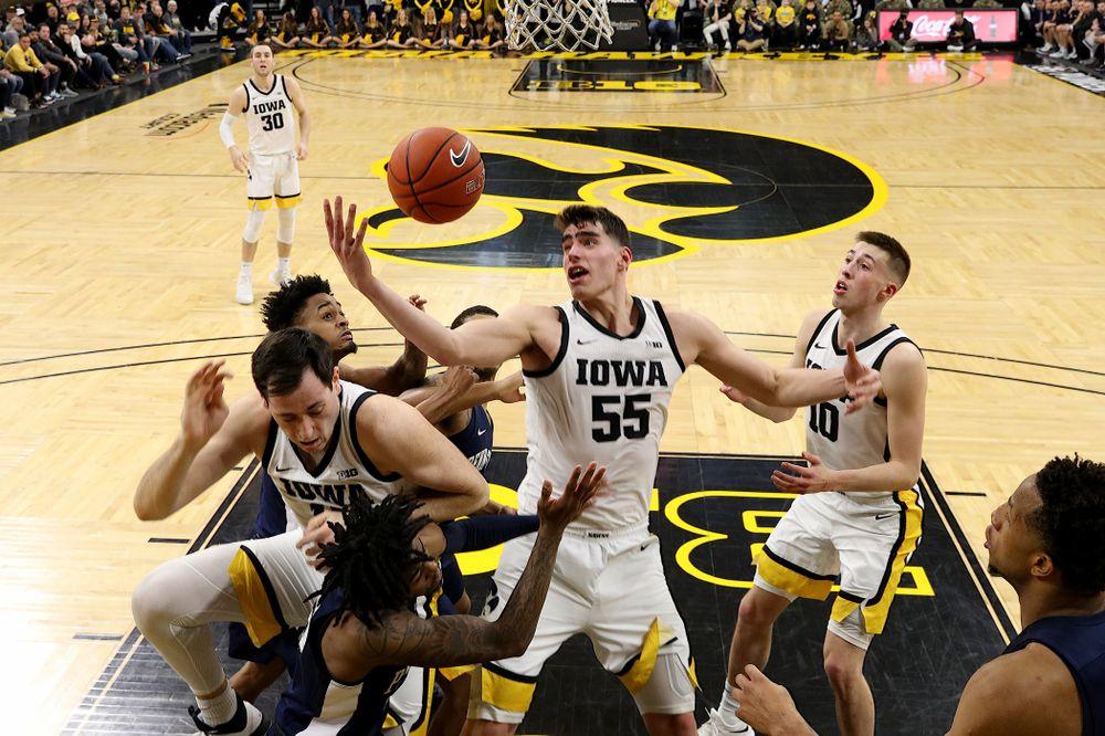 Iowa Hawkeyes forward Luka Garza (55) grabs a rebound against Penn State Saturday, February 29, 2020 at Carver-Hawkeye Arena. (Brian Ray/hawkeyesports.com)