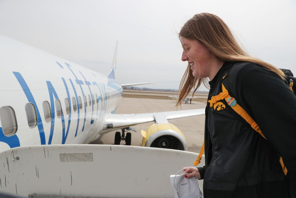 Iowa Hawkeyes center Monika Czinano (25) boards the team plane to Greensboro, NC for the Regionals of the 2019 NCAA Women's Basketball Championships Thursday, March 28, 2019 at the Eastern Iowa Airport. (Brian Ray/hawkeyesports.com)