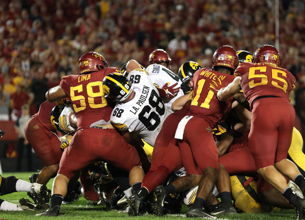 Iowa Hawkeyes quarterback Nate Stanley (4) fights his way into the end zone  against the Iowa State Cyclones Saturday, September 14, 2019 in Ames, Iowa. (Brian Ray/hawkeyesports.com)