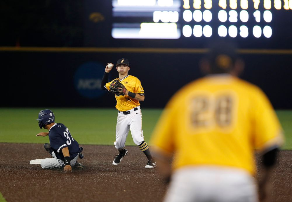 Iowa Hawkeyes infielder Mitchell Boe (4) turns a game ending double play against the Penn State Nittany Lions Saturday, May 19, 2018 at Duane Banks Field. (Brian Ray/hawkeyesports.com)