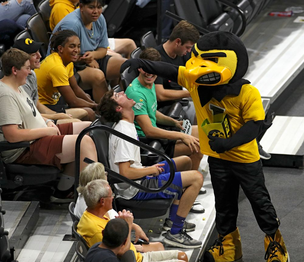 Herky tries to feed popcorn to a fan during the second set of their Big Ten/Pac-12 Challenge match against Colorado at Carver-Hawkeye Arena in Iowa City on Friday, Sep 6, 2019. (Stephen Mally/hawkeyesports.com)