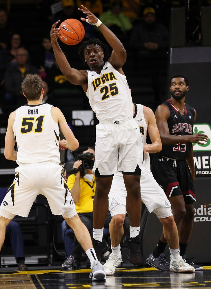Iowa Hawkeyes forward Tyler Cook (25) pulls down a rebound during a game against Guilford College at Carver-Hawkeye Arena on November 4, 2018. (Tork Mason/hawkeyesports.com)